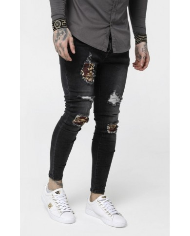 Sik Silk Low Rise Distressed Burst Knee Denims